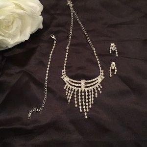 Rhinestone necklace. Bracelet and clip earrings.